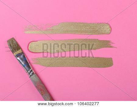 Paint on a pink background