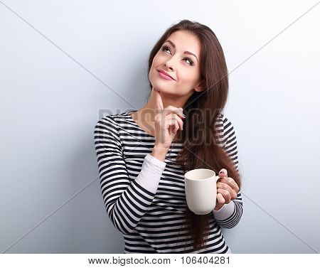 Thinking Concerned Young Woman Looking Up With Cup Of Coffee