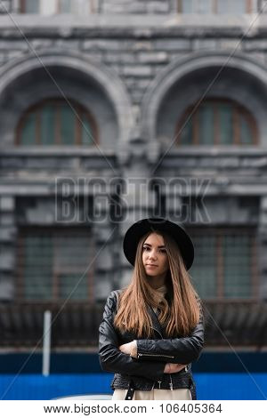 Young charming hipster girl with trendy look posing outdoors in autumn day