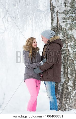 Young Couple Walking In Park In Winter