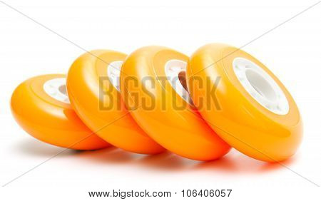 Orange wheels over white