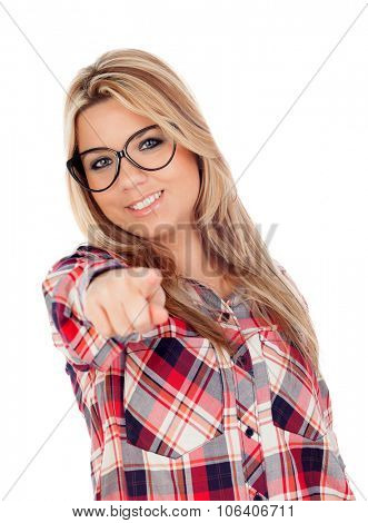 Cute Blonde Girl with glasses pointing at camera something isolated on a white background