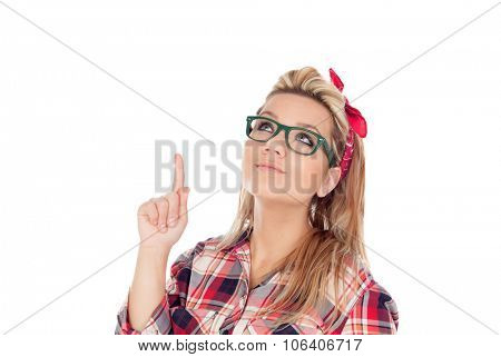 Cute Blonde Girl with glasses indicating something isolated on a white background