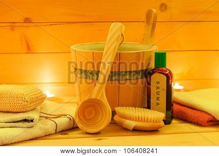 wooden sauna interior with accessories
