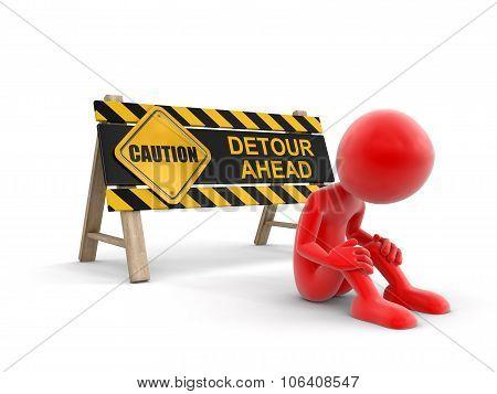 Detore ahead sign and man
