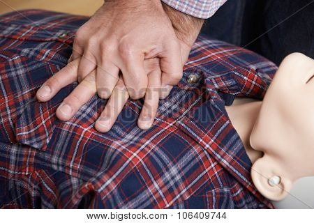 Man Using Cpr Technique On Dummy In First Aid Class