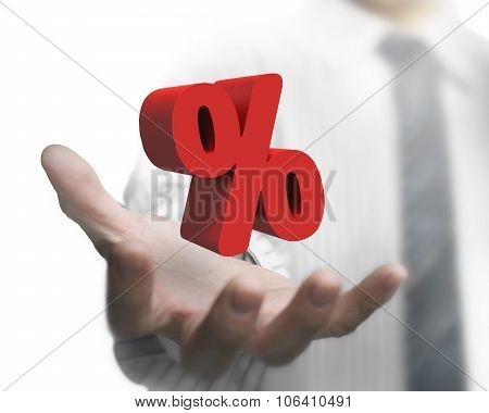 Businessman Hand Holding Red Percentage Sign