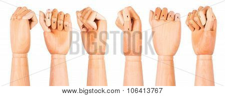 Closeup of right wooden hand - clenched fist
