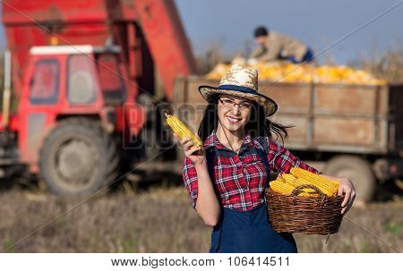 Woman Showing Harvested Corn