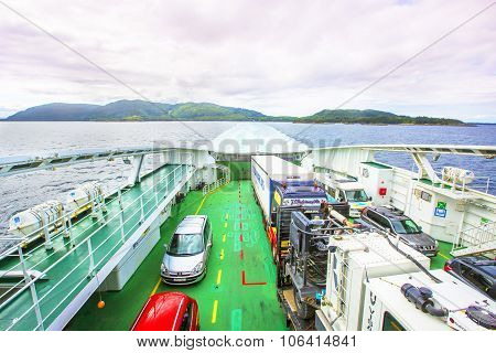 Ferry with cars on board.
