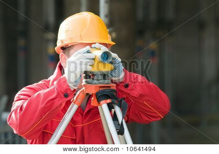 Surveor At Work With Level