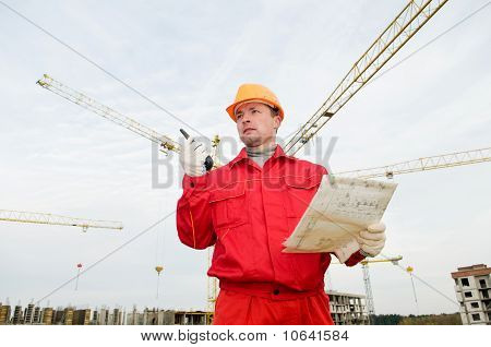 Builder Operating The Tower Crane