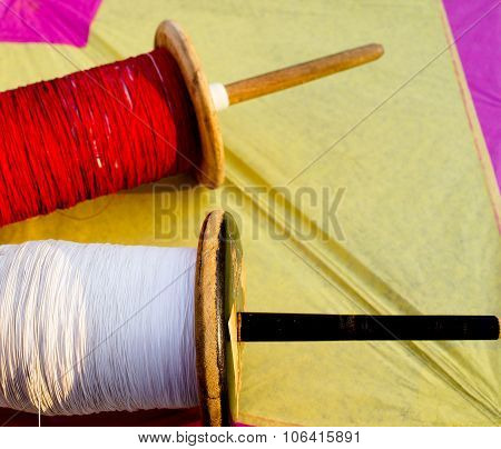 Colorful thread and a paper kite