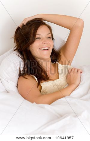 Bedroom - Woman Waking Up And Stretching