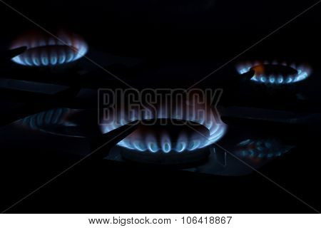Burning gas on the kitchen gas stove