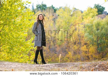 Young Girl Walking In The Autumn Forest