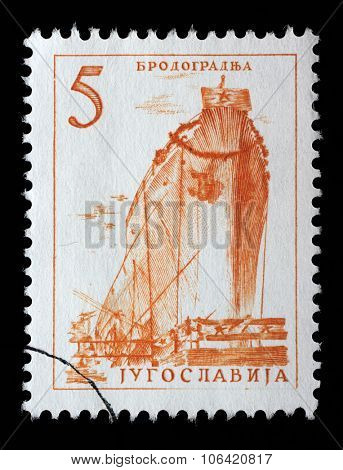 YUGOSLAVIA - CIRCA 1958: stamp printed by Yugoslavia, shows a ship in a shipyard, series, circa 1958