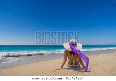 woman in sun hat and bikini at beach.remote tropical beaches and countries. travel concept