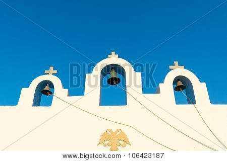Three Bells against the blue sky in Paros island in Greece.