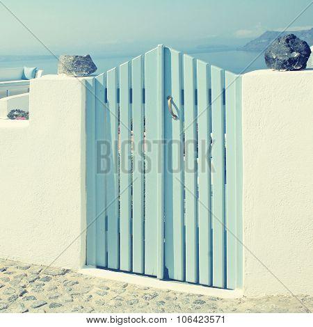 Blue Wooden Gates In White House, Santorini Island, Greece
