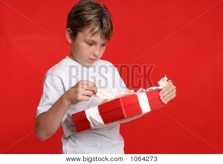 Child Opening A Present