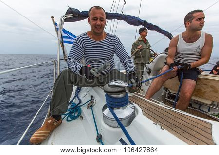 PYLOS, GREECE - CIRCA OCT, 2014: Unidentified sailors participate in sailing regatta 12th Ellada Autumn 2014 among Greek island group in the Aegean Sea, in Cyclades and Argo-Saronic Gulf.