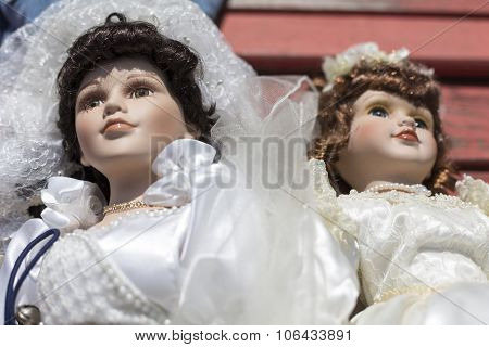 Old Puppet With Wedding Dress On A Flea Market