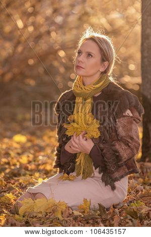 Beautiful woman with autumn leaves