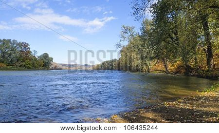 River Shoreline Landscape. Changing Leaves.