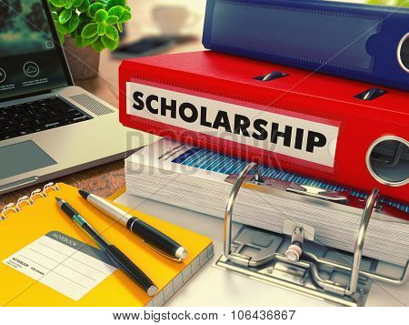 Red Office Folder with Inscription Scholarship.