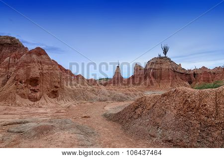Stunning Landscape Of Tatacoa Desert Under Deep Blue Evening Sky