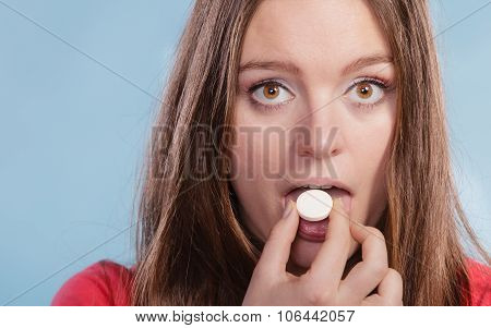 Woman Taking Vitamin C Supplement. Health Care