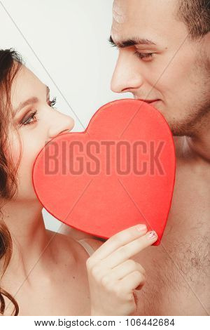 Loving Couple Kissing Behind Red Heart. Love.