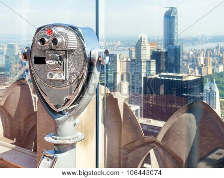 Binoculars looking at skyscrapers from an observation deck in New York City