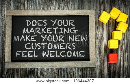 Does Your Marketing Make Your New Customers Fell Welcome? written on chalkboard
