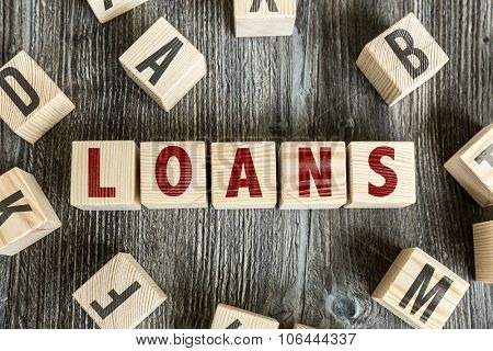 Wooden Blocks with the text: Loans