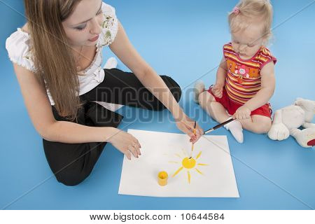 Cute Little Girl And Mother Drawing