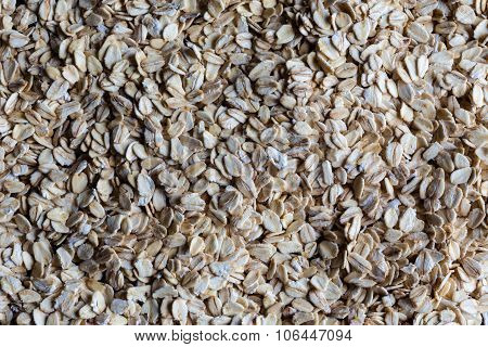 Rolled oats spread on surface from above