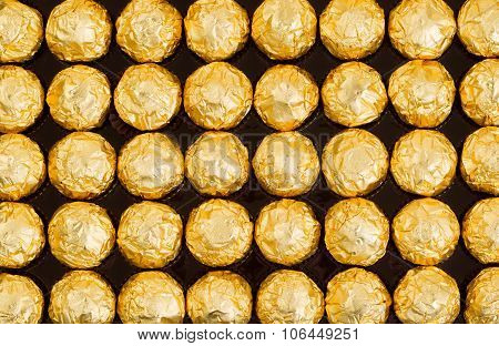 Box Of Candies Wrapped In Bright Golden Foil Wrappers