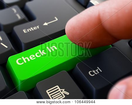 Finger Presses Green Keyboard Button Check In.