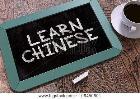 Handwritten Learn Chinese on a Chalkboard.