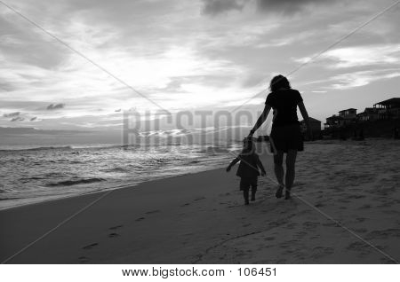 Mom And Daughter Walk On The Beach 3