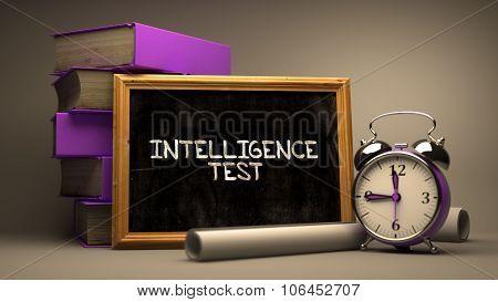 Intelligence TestHandwritten by white Chalk on a Blackboard.