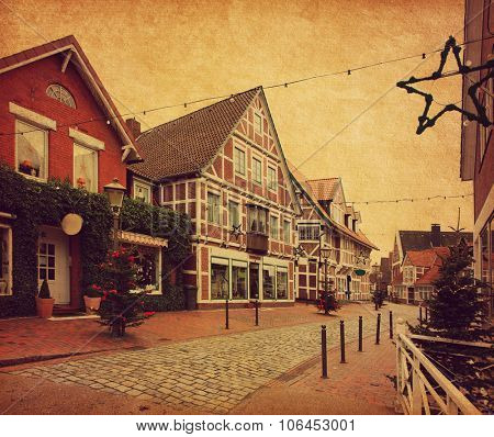 Old street in Jork.     Jork is a small town on the left bank of the Elbe, near Hamburg.  Photo in retro style. Paper texture.