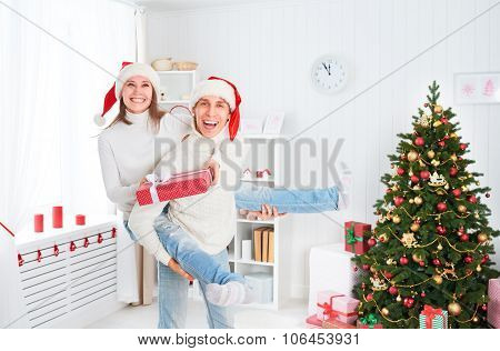 Happy Funny Couple Plays Fool And Having Fun On Christmas At Home