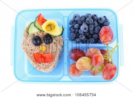 Lunch box with creative sandwich and fruits isolated on white background