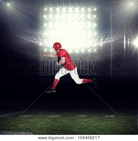 American football player running with the ball against american football arena