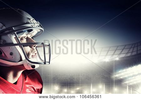 American footballer looking up against rugby stadium