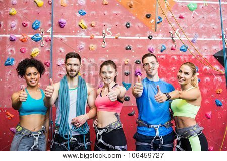 Fit people getting ready to rock climb at the gym