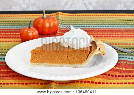 Pumpkin Pie Slice With Whipped Cream.